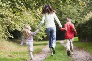 Woman-Skipping-With-Children